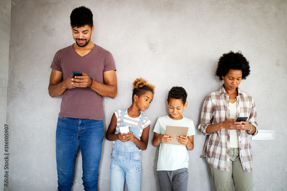 Fototapeta Family sharing there privacy data by using digital devices, phones, tablets