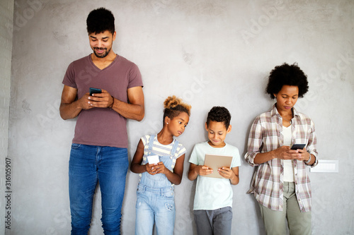 Fototapeta Family sharing there privacy data by using digital devices, phones, tablets obraz