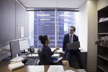 Lawyers Talking In Office