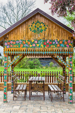 Colorful Painted With Flower Motifs Pavilion In The Garden. Zalipie, Poland.