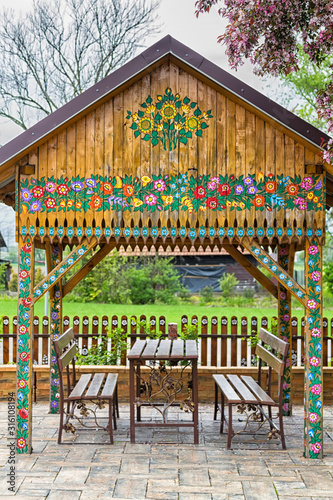Colorful painted with flower motifs pavilion in the garden Canvas Print