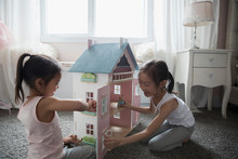 Sisters Playing With Dollhouse...