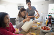 Mother and daughters eating breakfast in kitchen