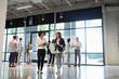 Businesswomen walking and talking, networking in office lobby