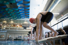 Swimmers Ready On Starting Platform At Swimming Pool