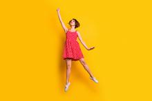 Full Size Photo Of Cute Cheerful Pretty Girl Jump Hold Hand Want Catch Flying Parasol Wear Good Look Vintage Style Skirt Shoes Isolated Over Yellow Color Background