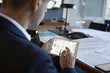 Male designer reviewing digital proofs on digital tablet in conference room