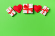 Leinwandbild Motiv Holiday composition of gift boxes and red textile hearts on colorful background with empty space for your design. Top view of Valentine's Day concept