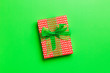 canvas print picture - Top view Christmas present box with green bow on green background with copy space
