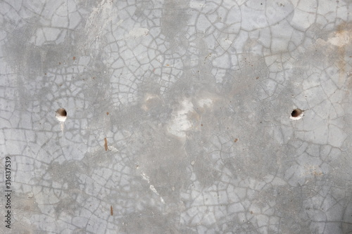 Fototapeta Cracks holes on the gray cement concrete wall Caused by drilling, crack wall texture obraz