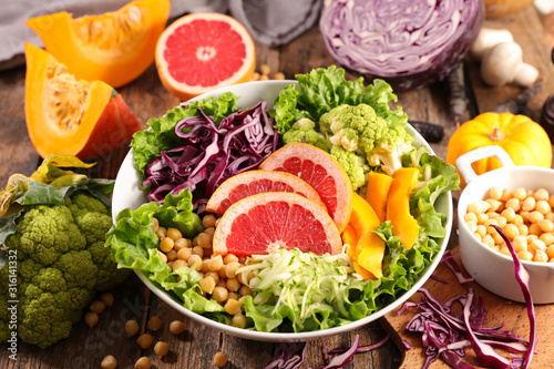 Obraz vegetarian salad bowl with lettuce, chickpea, grapefruit and cabbage - fototapety do salonu