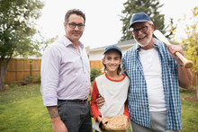 Portrait Smiling Multi-generation Family Men Playing Baseball In Backyard