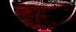 canvas print picture - Red wine on black background, abstract splashing. Macro shot