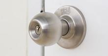 Aluminum Door Knob On The Whit...