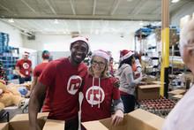 Portrait Smiling Volunteers In...