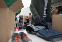 Volunteers Sorting Donations I...