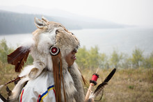 Native American Indian In Traditional Clothing Animal Skins Looking At River