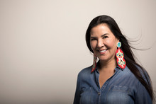 Portrait Smiling, Confident Mature Native American Woman With Colorful Earrings