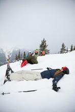 Playful Female Skier Making Snow Angels