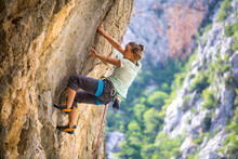 Climber Trains On The Rocks Of...