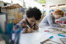 Focused Preschool Boy Drawing ...