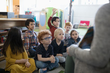 Preschool Students Listening To Story Time In Classroom