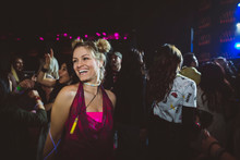 Confident, Carefree Female Millennial Dancing And Partying In Nightclub