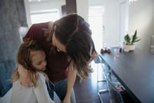 Affectionate Mother Hugging Daughter