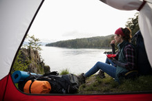 Woman Eating, Camping On Cliff...