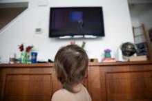 Curious Baby Boy Watching TV