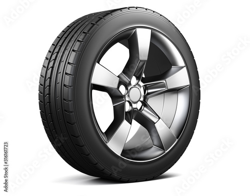 Photo Alloy wheel with tyre  isolated on white