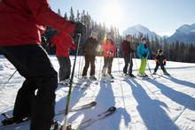 Family Receiving Group Ski Lesson From Ski Resort Instructor