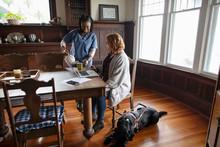 Home Caregiver Pouring Tea For...