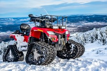 Rescue Snowmobile With Winch , Winter Motorcycle. Snowmobile.  Winter ATVs In Winter Against The Backdrop Of The Mountain . Caterpillar Transport