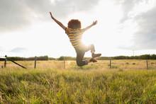 Playful Teenage Girl Jumping F...