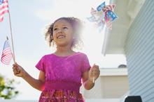 Happy Girl Holding American Fl...