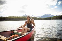 Serene Mature Woman Canoeing O...