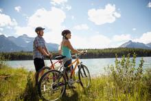 Mature Couple Mountain Biking ...