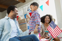 Happy Family With American Fla...
