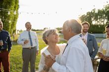 Affectionate Senior Bride And Groom Dancing