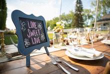 Love Sweet Love Blackboard Sign On Wedding Reception Patio Table