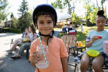 Portrait Cute Boy In Bike Helm...