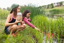 Curious Girl Friends Fishing A...