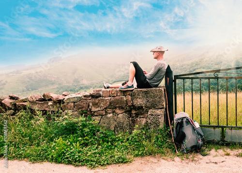 Fotografie, Obraz Lonely Pilgrim with backpack resting