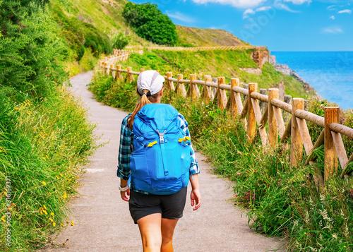 Lonely Pilgrim with backpack walking the Camino de Santiago in Spain, Way of St Fototapete