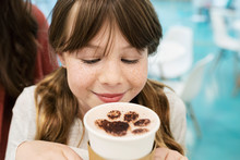Curious Girl Drinking Hot Choc...
