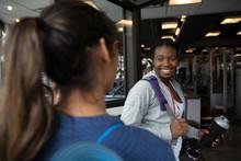 Smiling Women Arriving At Gym