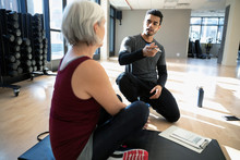 Personal Trainer Talking With ...