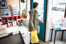 Female Shopper Leaving Art Sup...
