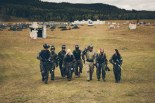 Friends Walking Out To Paintballing Field